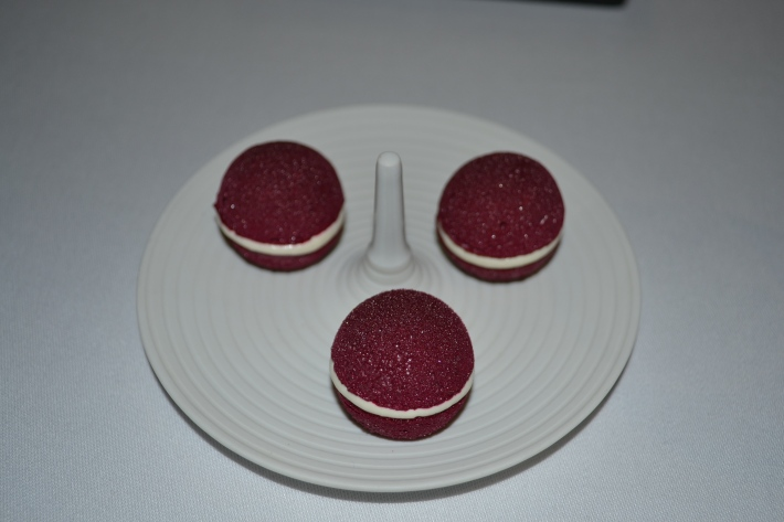 Beetroot macaron with horseradish cream